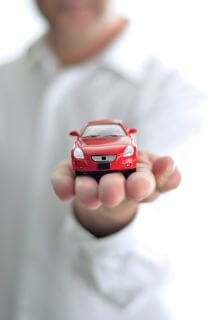 Businessman presents a car